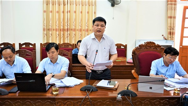 Đồng chí Trần Quốc Bảo, UV BTV, Phó Chủ tịch UBND huyện báo cáo....